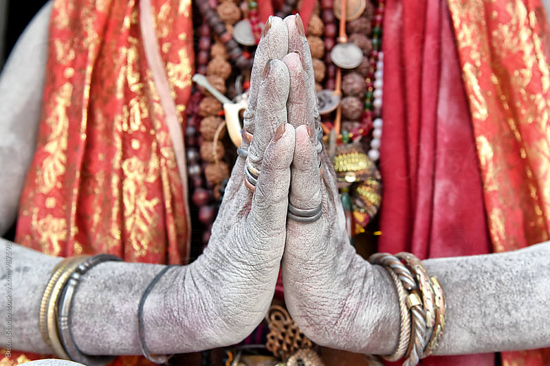 Detail of a sadhu's hands praying on a temple by Bisual Studio for Stocksy United
