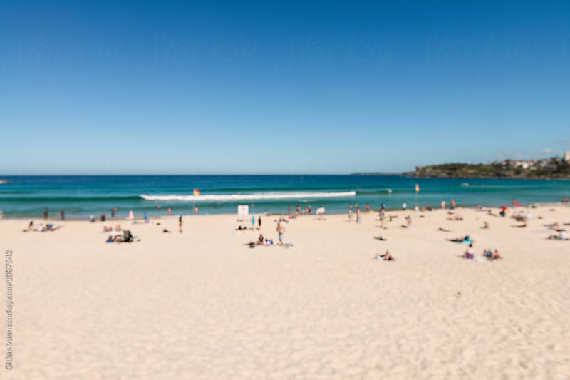 blurred image of people at the beach, Bondi, Sydney, Australia by Gillian Vann for Stocksy United