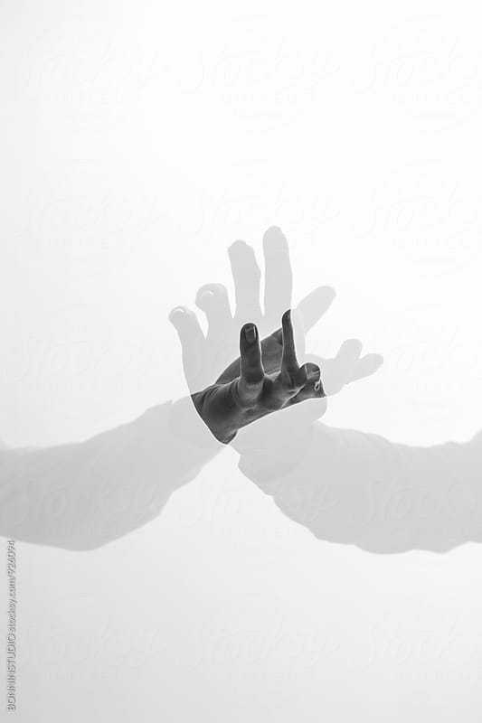 Double exposure hands.  by BONNINSTUDIO for Stocksy United