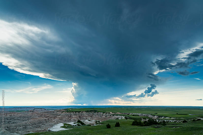 Storm clouds over Badlands National Park, South Dakota by Adam Nixon for Stocksy United