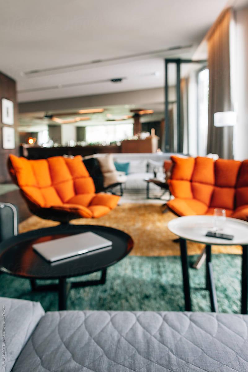 Orange Designer Chairs In Hotel Lobby Defocused By Visualspectrum