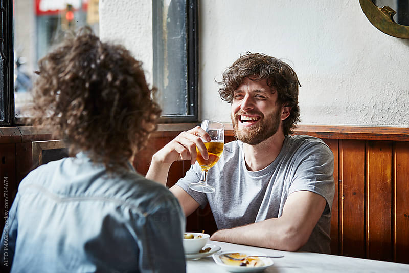 Man Having Wine While Looking At Woman In Restaurant by ALTO IMAGES for Stocksy United