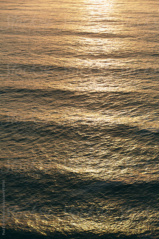 Ocean waves and surf at dusk by Paul Edmondson for Stocksy United