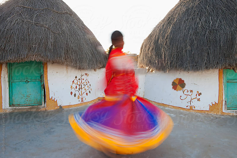 Spinning dancer in the Thar Desert. Jaisalmer. Rajasthan. India by Hugh Sitton for Stocksy United