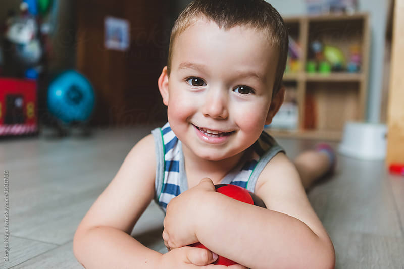 Happy Male Toddler at Home Looking at Camera by Giorgio Magini for Stocksy United
