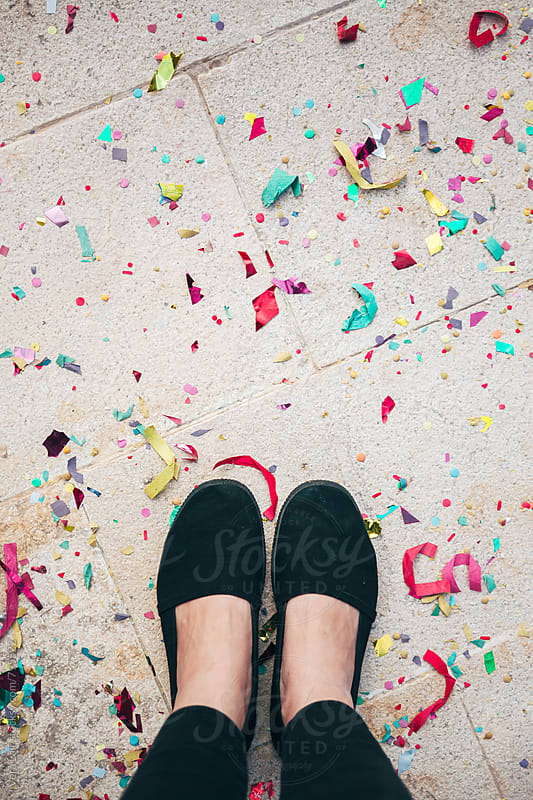 Woman feet and confetti on the floor by Vera Lair for Stocksy United