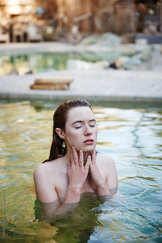 Woman relaxing in Japanese hot springs and spa by Trinette Reed for Stocksy United