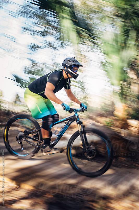 Mountain bike rider on a trail by Gabriel (Gabi) Bucataru for Stocksy United