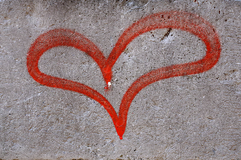 painted heart on a wall by Marcel for Stocksy United