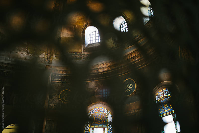 Interior of Hagia Sophia seen through an out of focus carved screen. by Julia Forsman for Stocksy United