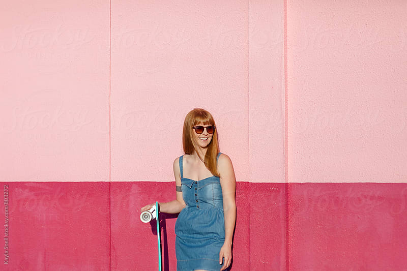 Young woman with a longboard by Kayla Snell for Stocksy United