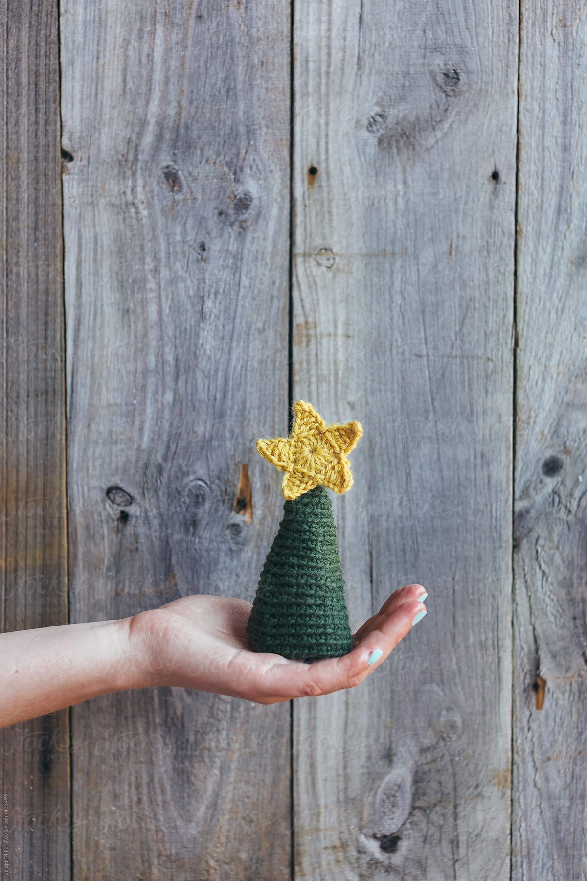 Girls Hand Holding A Crocheted Christmas Tree With Gold Star In Front Of Wood Fence By Jacqui Miller Christmas Xmas Stocksy United