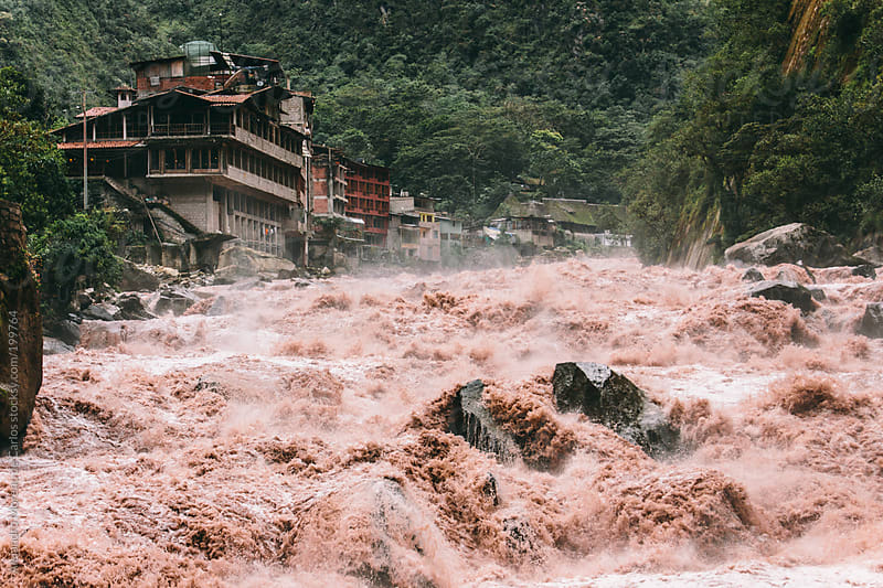 River with raging waters in Aguas Calientes, Peru by Alejandro Moreno de Carlos for Stocksy United