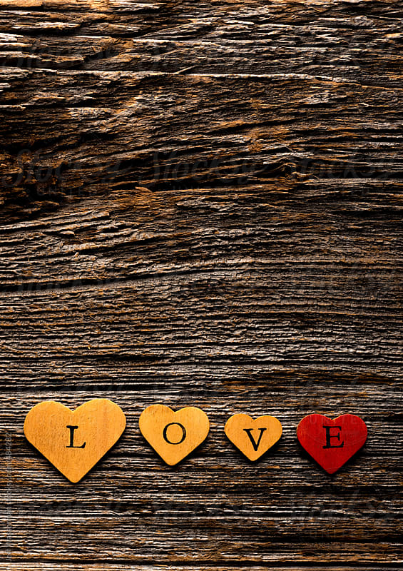 Concept Love:  Spelled Out in Wood Hearts by Jeff Wasserman for Stocksy United
