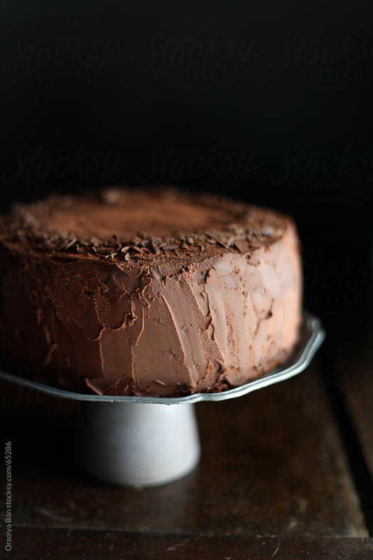 Chocolate Cake with dark background by Orsolya Bán for Stocksy United