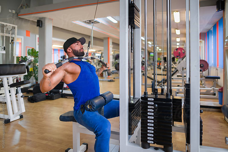 Bodybuilder doing chest training with bar by RG&B Images for Stocksy United