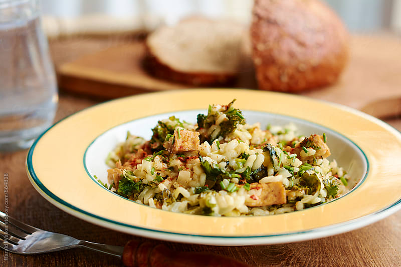 Kale Risotto with Spicy Tofu Pieces by Harald Walker for Stocksy United