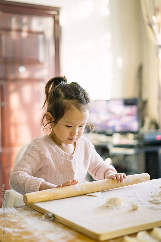 Toddler kid making Chinese Dumplings by MaaHoo Studio for Stocksy United