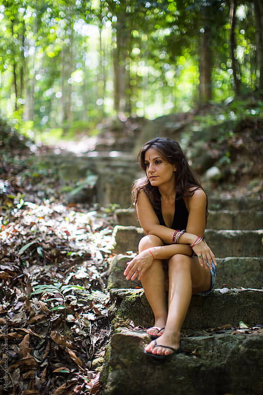Woman Sitting on the Stairs in a Park by Mosuno for Stocksy United