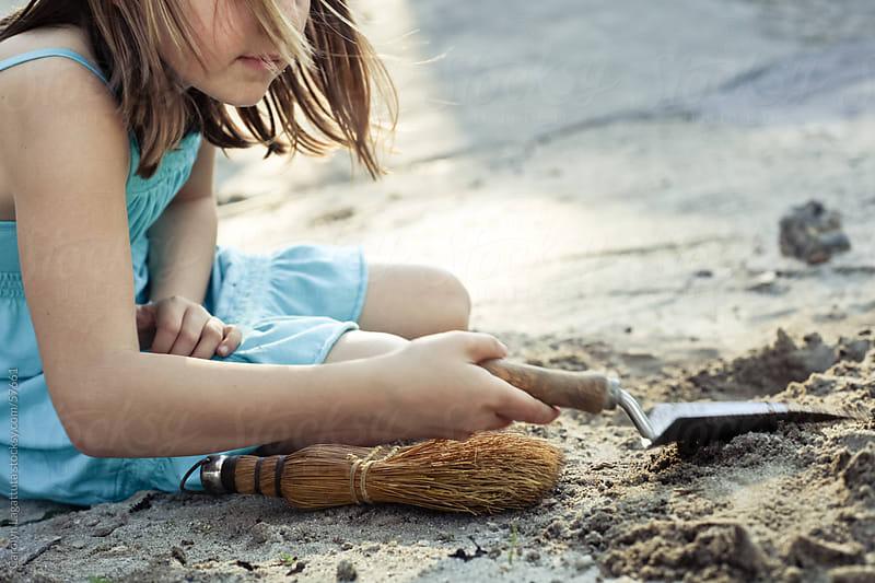 Little girl digging for fossils by Carolyn Lagattuta for Stocksy United