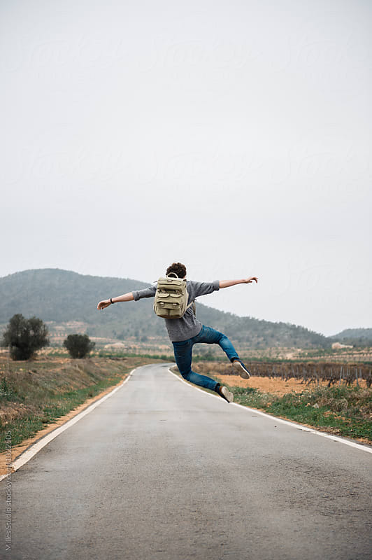 Man Hitchhiking by Milles Studio for Stocksy United