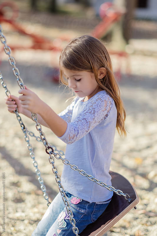 Cute Little Girl on the Swing by Aleksandra Jankovic for Stocksy United