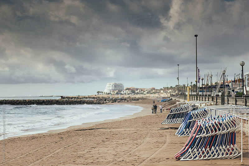 beach at winter with storm clouds by Javier Pardina for Stocksy United