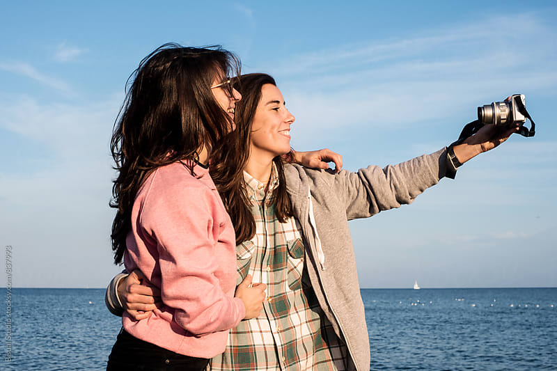 Winter selfie by the sea, Barcelona by Bisual Studio for Stocksy United