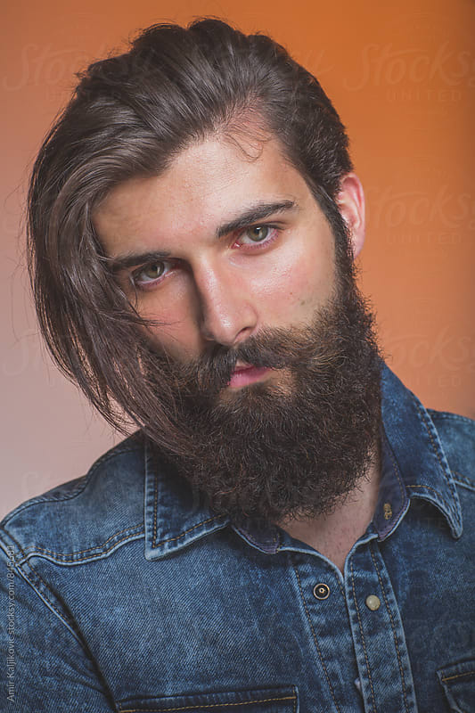 Pensive handsome trendy bearded man by Amir Kaljikovic for Stocksy United