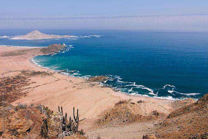 Blue ocean and desert by Alejandro Moreno de Carlos for Stocksy United
