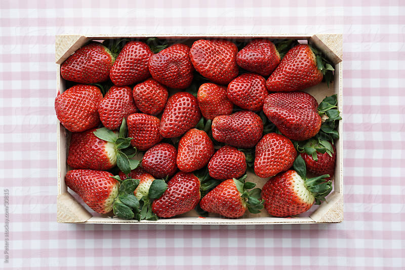 Food: Strawberries in a crate by Ina Peters for Stocksy United