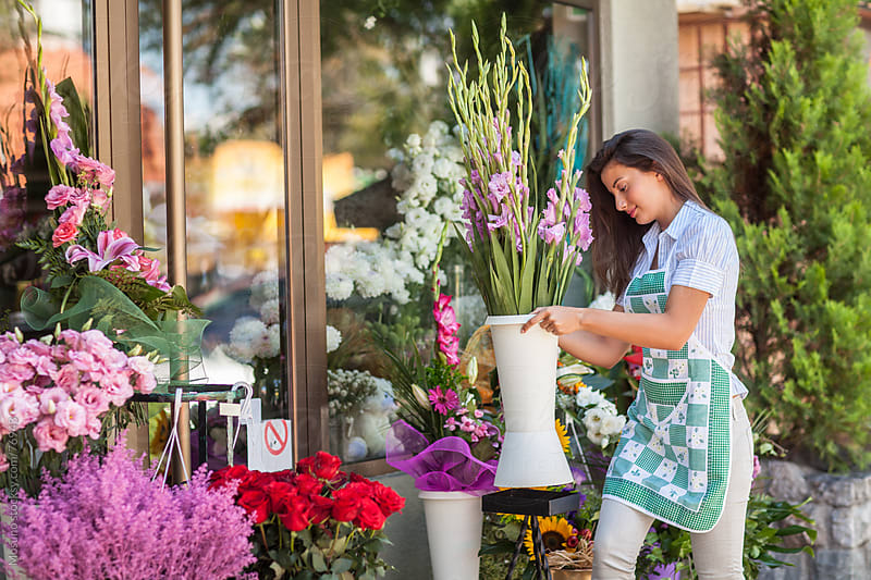 Florist working in her shop. by Mosuno for Stocksy United
