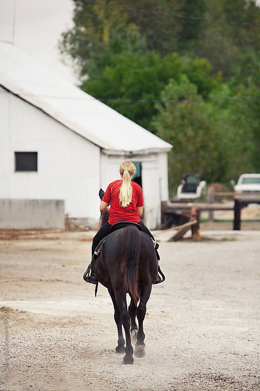 Equestrian: Girl Riding Horse Back to Stable by Sean Locke for Stocksy United