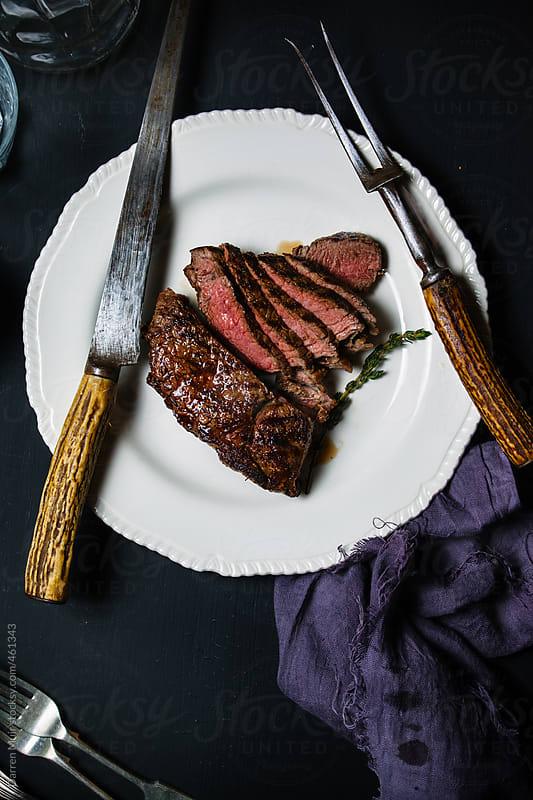 Carved beef rump. by Darren Muir for Stocksy United