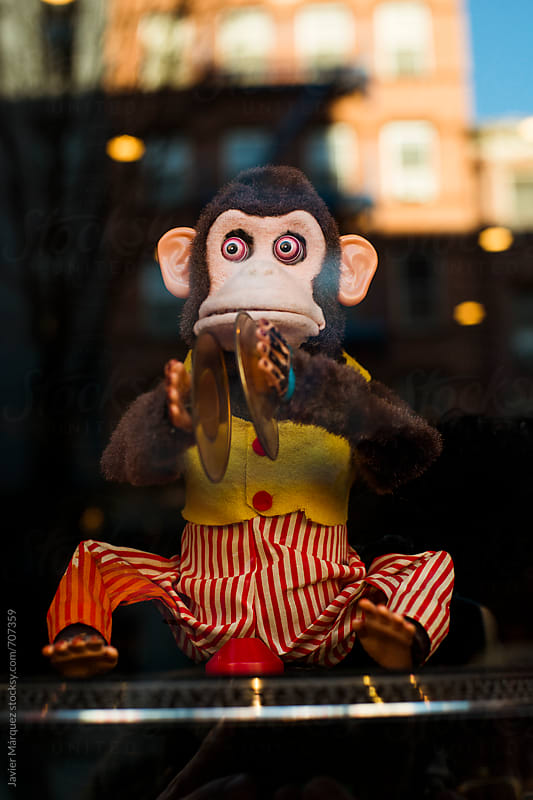 Toy monkey with dashes by Javier Marquez for Stocksy United