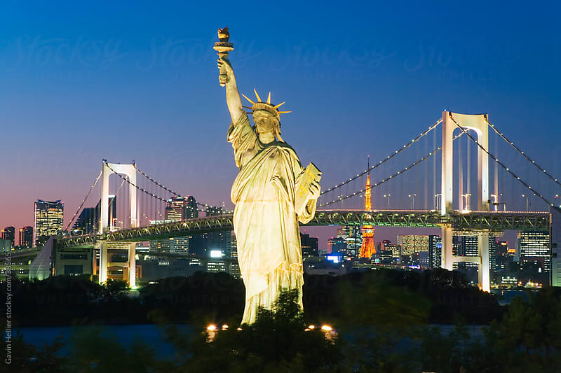 Asia, Japan, Tokyo, Tokyo Bay, Odaiba, Rainbow Bridge, Tokyo Tower and the replica Statue of Liberty illuminated at dusk by Gavin Hellier for Stocksy United