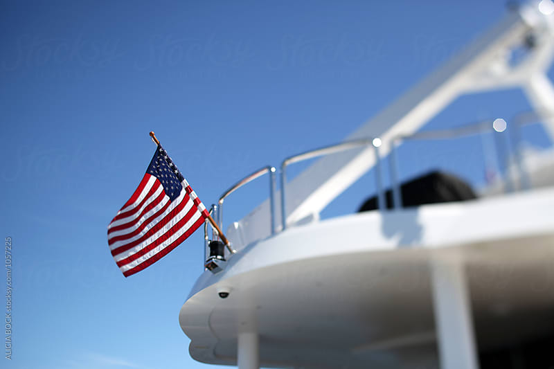The American Flag On The Back Of A Yacht by ALICIA BOCK for Stocksy United