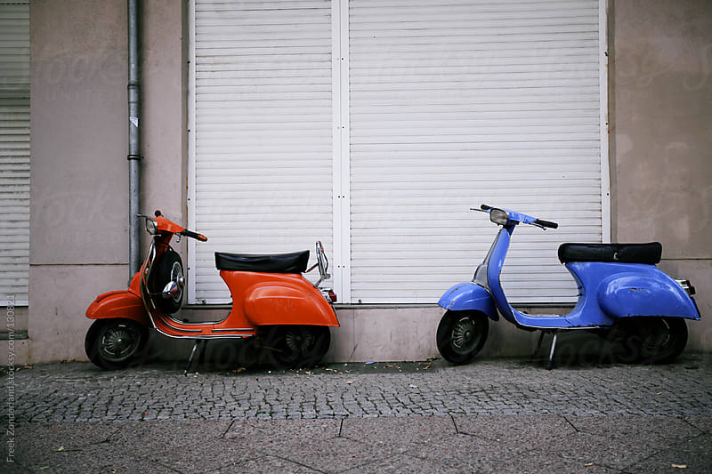 Orange and Blue Pair of Scooters by Freek Zonderland for Stocksy United