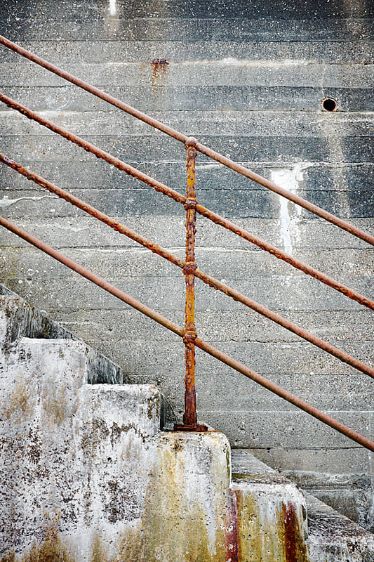 Staircase by a distressed wall by James Ross for Stocksy United