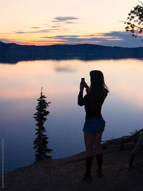 Girl, Lake, Smartphone by Ryan Matthew Smith for Stocksy United