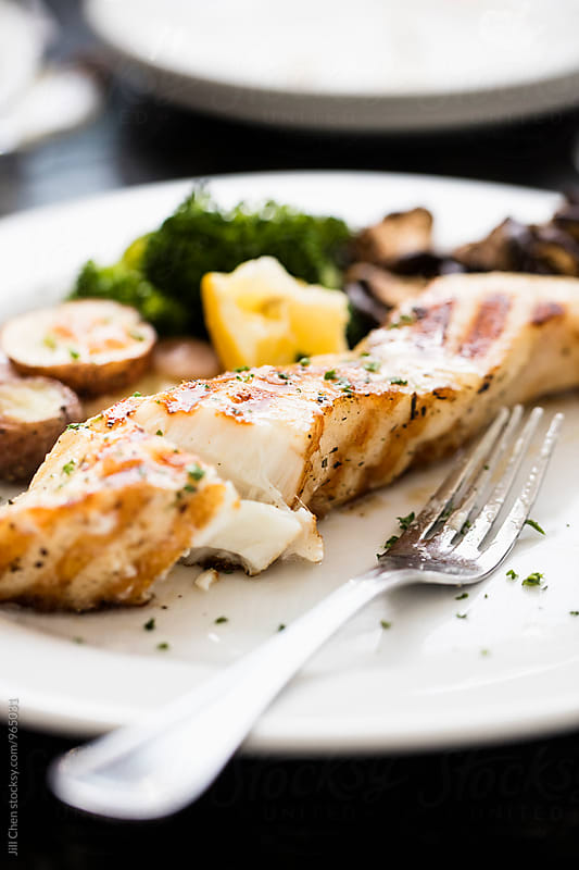 Grilled Chilean Sea Bass by Jill Chen for Stocksy United