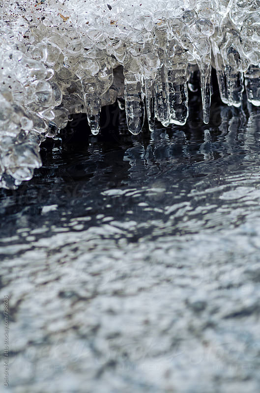 stream with icicles by Deirdre Malfatto for Stocksy United