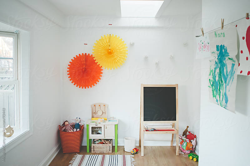 playroom with toys, chalkboard and kitchen by Meaghan Curry for Stocksy United