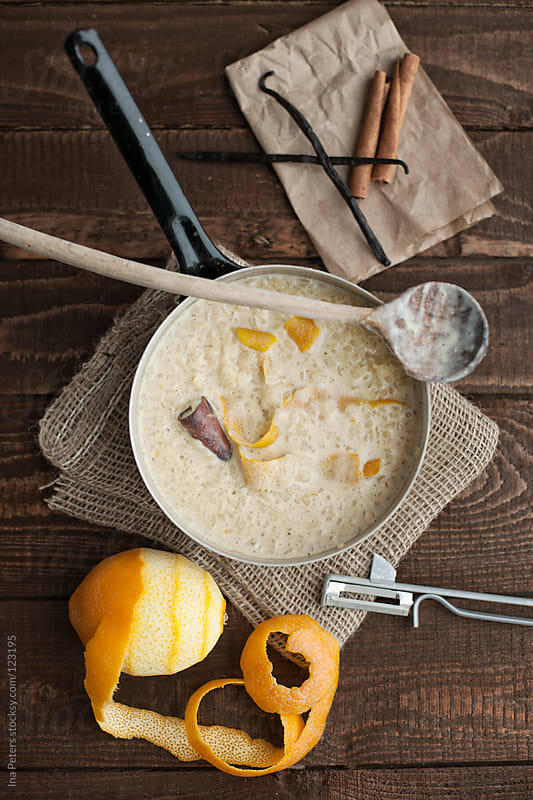Food: Arroz Con Leche, rice pudding cooked with orange, lemon an by Ina Peters for Stocksy United