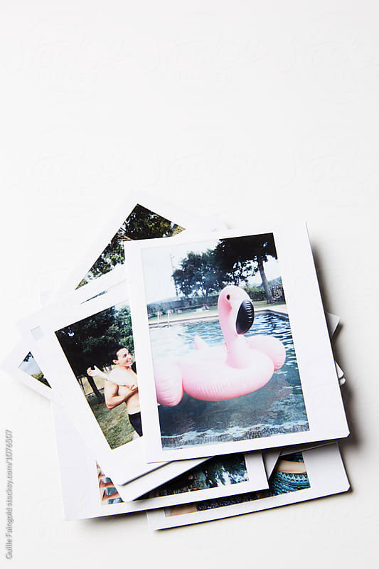 Stack of instant photos  by Guille Faingold for Stocksy United