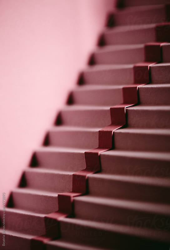 Minimal photo of pink stairs with shadow and light by Beatrix Boros for Stocksy United