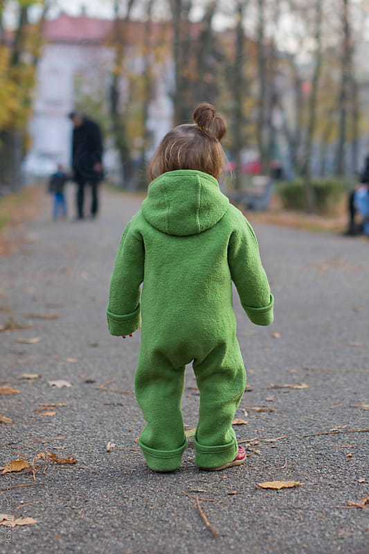 Toddler standing in the middle of the park alley  by RG&B Images for Stocksy United