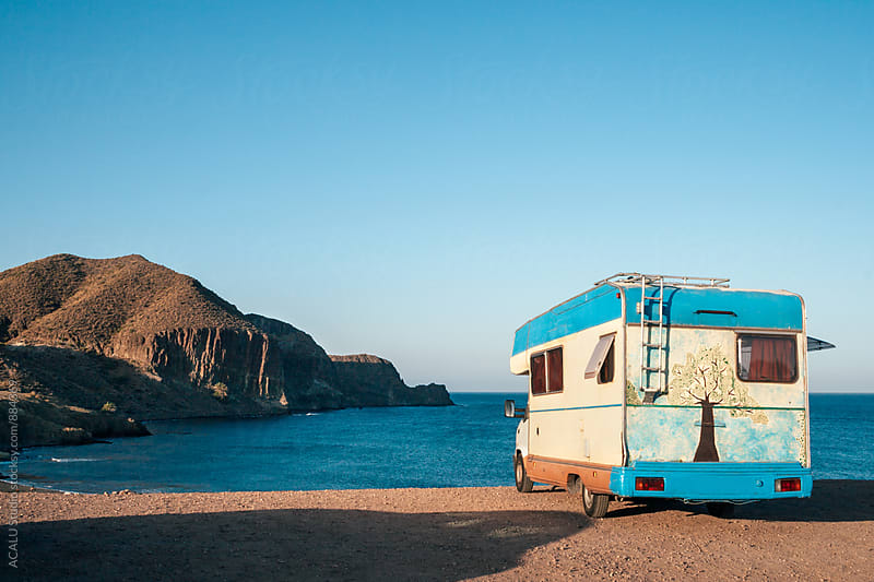 Hippie camper watching the sea by ACALU Studio for Stocksy United