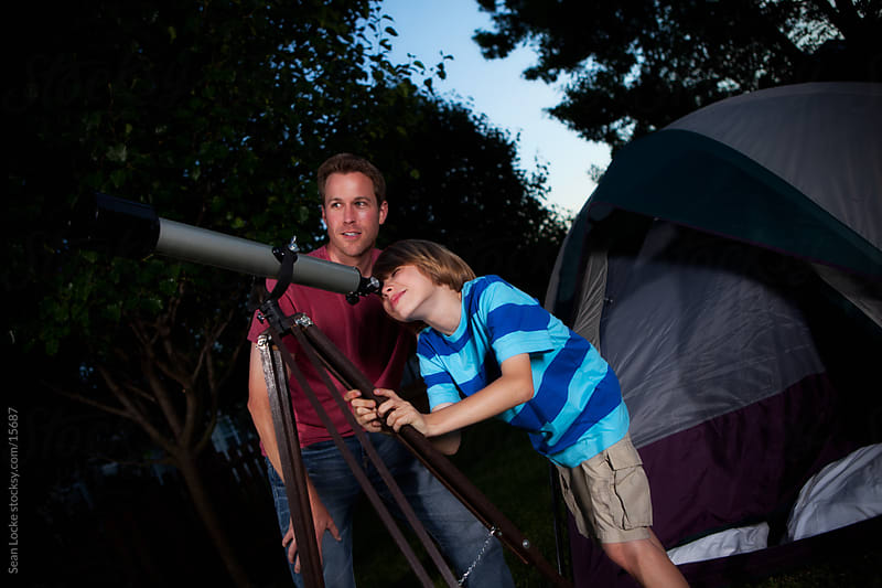 Camping: Father and Son Use Telescope by Sean Locke for Stocksy United