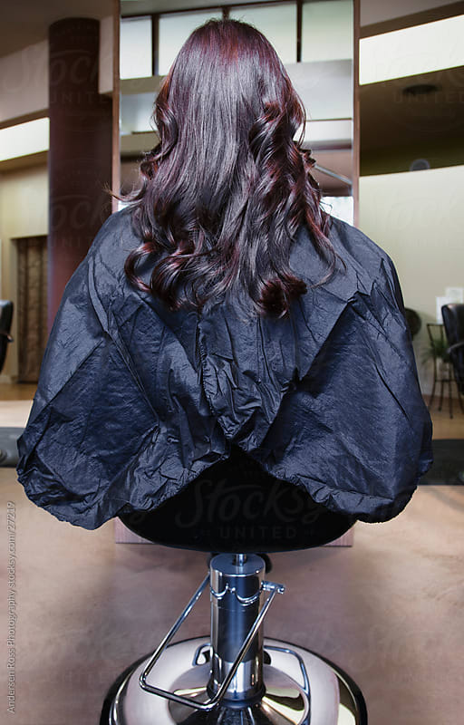 woman about to get hair styled at salon by Andersen Ross Photography for Stocksy United
